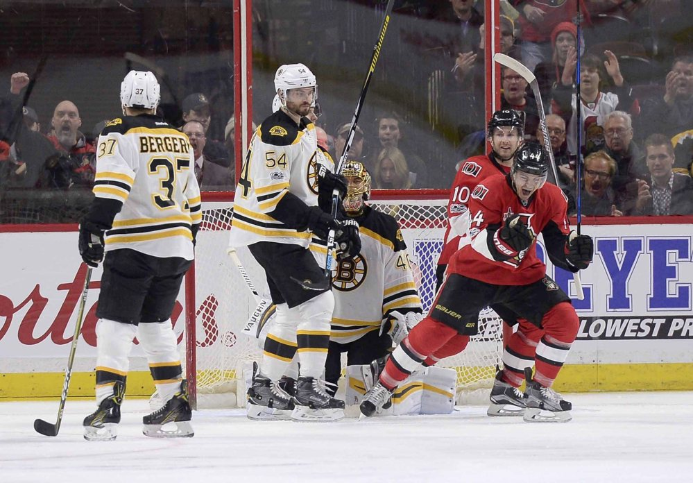 The Senators' Jean-Gabriel Pageau celebrates a goal on Bruins goaltender Tuuka Rask in the first period Monday night as the Senators jump out to an early 2-0 lead.