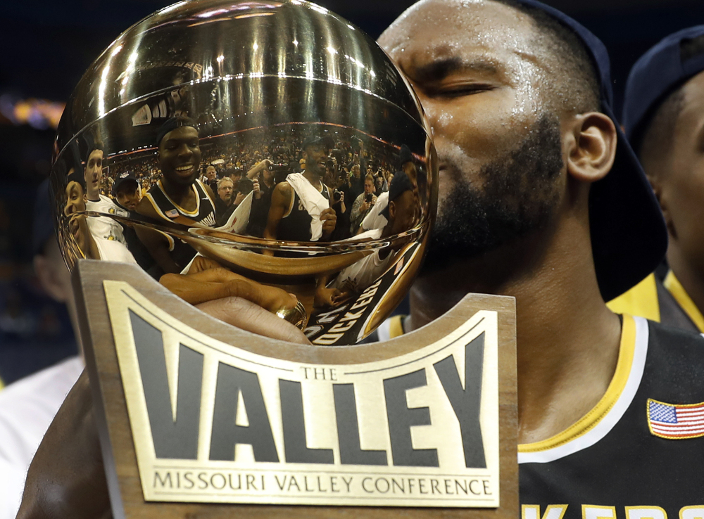 Wichita State's Shaquille Morris kisses the trophy after beating Illinois State 71-51 Sunday at St. Louis to win the Missouri Valley Conference tournament.