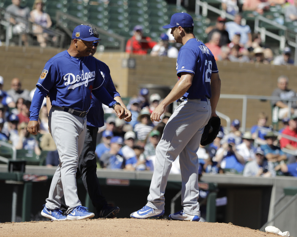 Los Angeles Dodgers manager Dave Roberts, seen at a spring training game in March, often gets credit for balancing the demands of the Dodgers' data-driven front office and the hearts of the ballplayers.