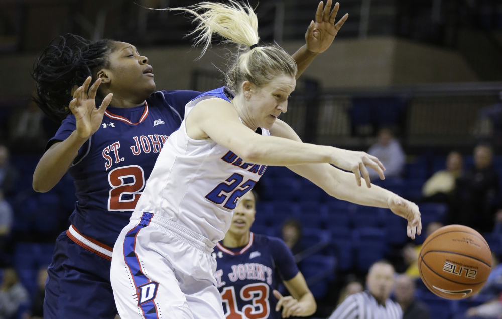 DePaul's Brooke Schulte, right, loses the ball against St. John's Jade Walker during the first half of a 59-41 win by DePaul in a semifinal game of the Big East tournament Monday at the Al McGuire Center in Milwaukee.