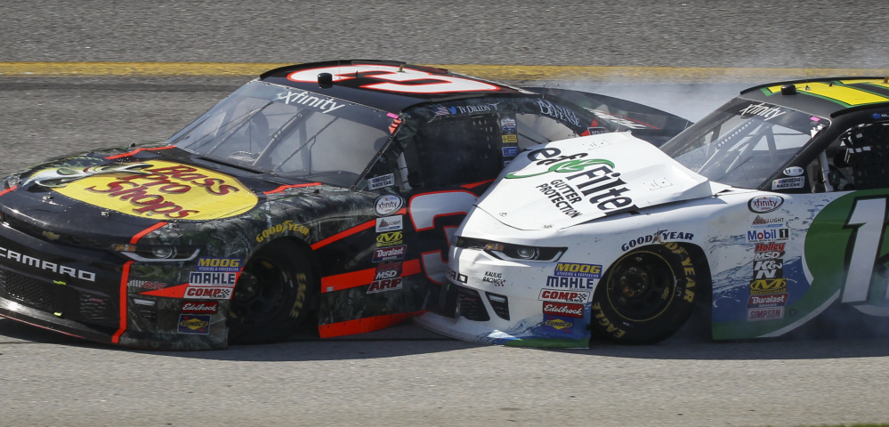 Austin Dillon, left, put Denny Hamlin out of the XFinity race Saturday with this collision at Atlanta Motor Speedway in Hampton, Ga. A day later, Dillon seemed partly to blame for a yellow flag that likely cost Kevin Harvick a win.