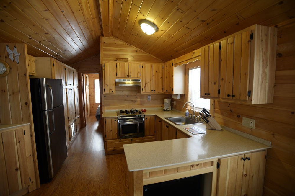 One of the tiny house units has handmade pine cabinets and wood laminate flooring.