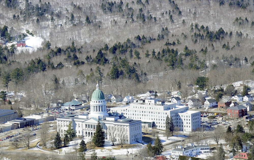 This aerial photo taken on March 27, 2014, shows Howard Hill, 164 wooded acres that serve as the scenic forested backdrop for the State House in Augusta.