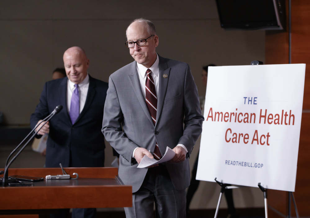 House Ways and Means Committee Chairman Rep. Kevin Brady, R-Texas, left, follows House Energy and Commerce Committee Chairman Rep. Greg Walden, R-Oregon, to a news conference on Capitol Hill in Washington on Tuesday as House Republicans introduce their plan to repeal and replace the Affordable Care Act.