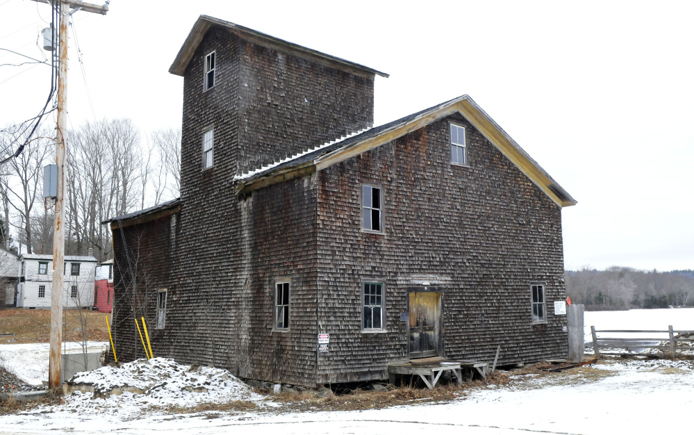 The mill on Branch Mills Road in South China, seen Tuesday, is being dismantled. When the job is finished, the site is expected to be purchased by the Atlantic Salmon Federation.