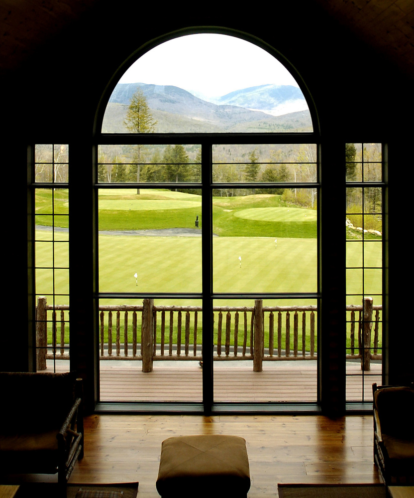 The clubhouse at the Sunday River Golf Club offers this view of the Mahoosuc Mountain range and the practice putting green. Construction of the course began in 2003 and was completed in 2005.