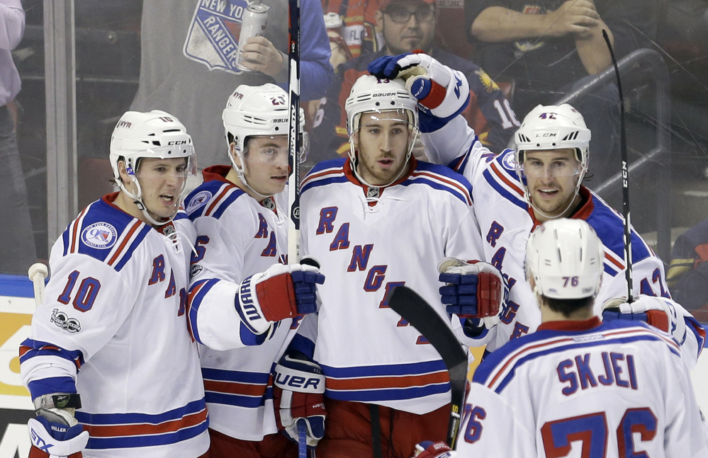 Kevin Hayes of the Rangers gets congratulated by J.T. Miller, 10, Jimmy Vesey, 26, Brendan Smith, 42, and Brady Skjei after scoring a second-period goal Tuesday night against the Panthers at Sunrise, Fla.