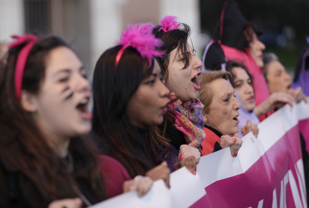 Women chant slogans as they march during a demonstration demanding equal rights for women and men, as they mark International Women's Day  in Rome on Wednesday.