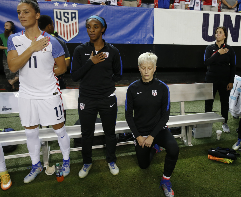 Megan Rapinoe, while playing for the U.S. women's national soccer team, wouldn't stand for the anthem, but now says she'll abide by the federation's mandate to show respect.