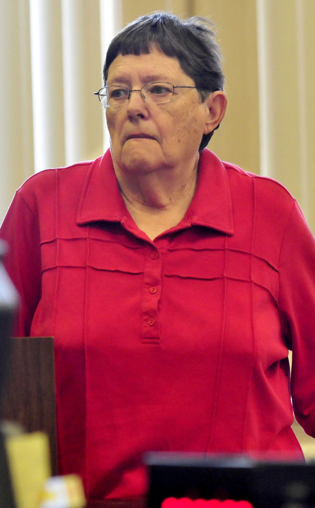 Mary O'Donal listens to Justice Robert Mullen during sentencing Thursday after her conviction of theft from Care and Share Food Closet in Farmington.