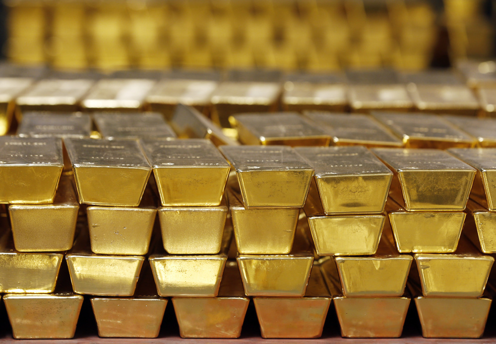Gold sits in a vault in West Point, N.Y. The Federal Reserve's economic stimulus and a recovery in corporate profits have led a stock market rebound over the past eight years.