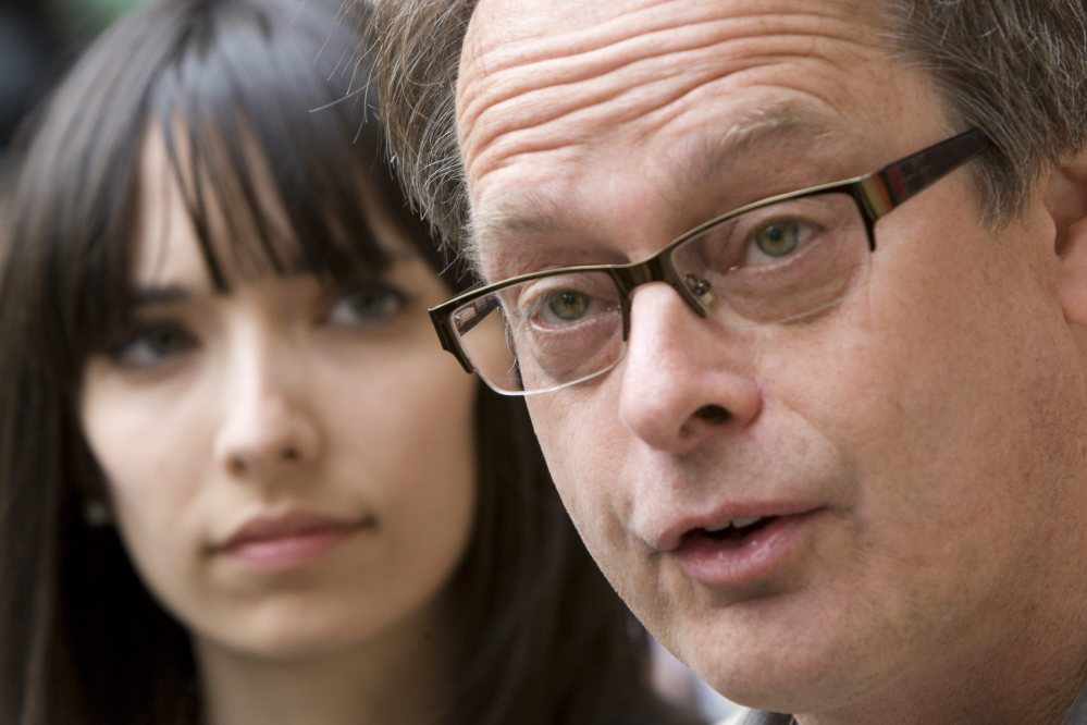 Pot stores owned by Marc Emery and his wife, Jodie, left, were raided Thursday.
