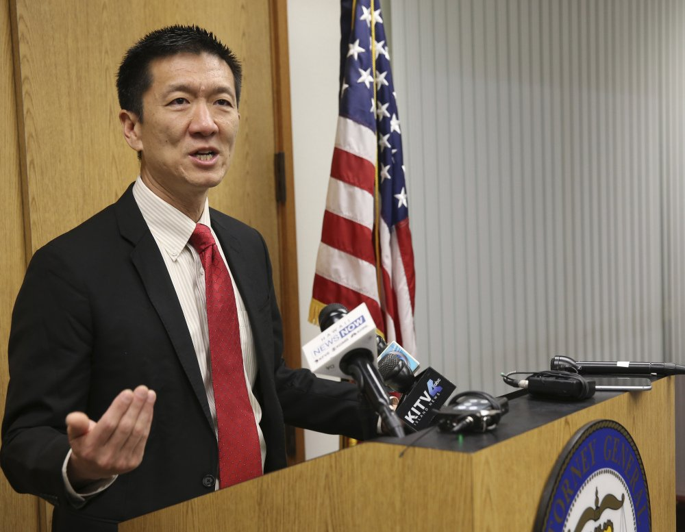 Hawaii Attorney General Douglas Chin speaks at a news conference Thursday. Chin's office filed an amended lawsuit against President Trump's revised travel ban.