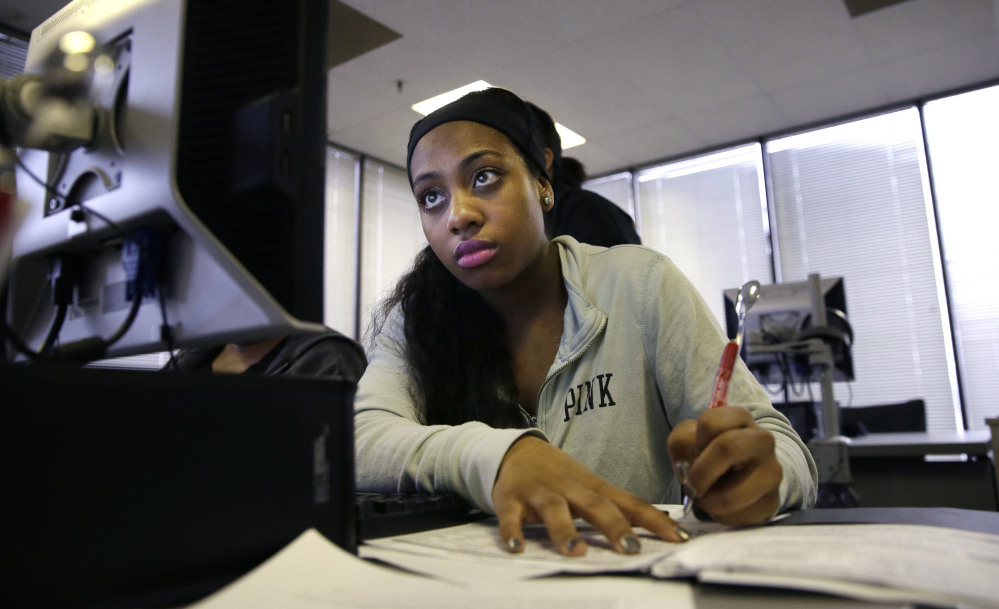 Job seeker Kiana Cupit works on her resume during a resume writing class at the Texas Workforce Solutions office in Dallas on Friday. U.S. employers added a robust 235,000 jobs and raised pay at a healthy pace in February, making it likely that the Federal Reserve will raise interest rates next week.