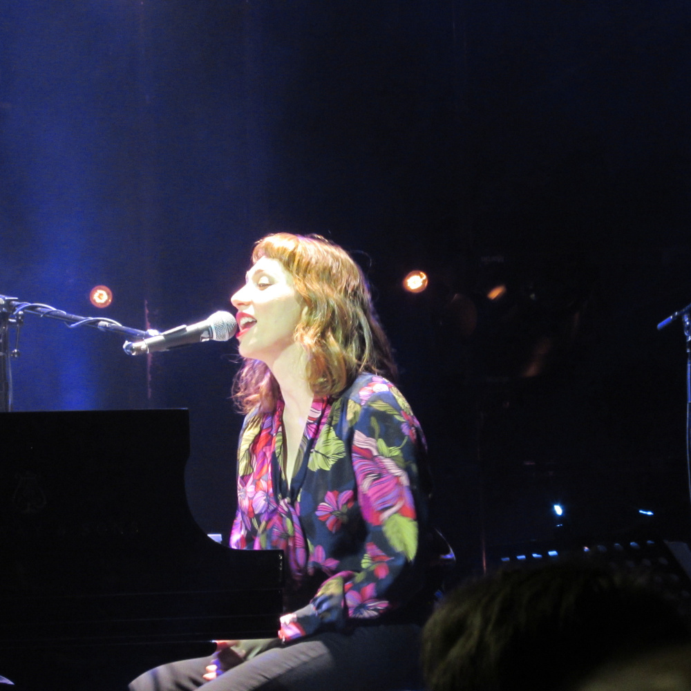 Regina Spektor performs at the State Theater in Portland on Thursday. She played the piano and sang songs from most of her albums, delighting a sold-out crowd.