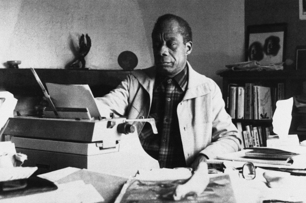 American writer James Baldwin poses in front of his typewriter in his house, March 15, 1983, Saint Paul de Vence, France.