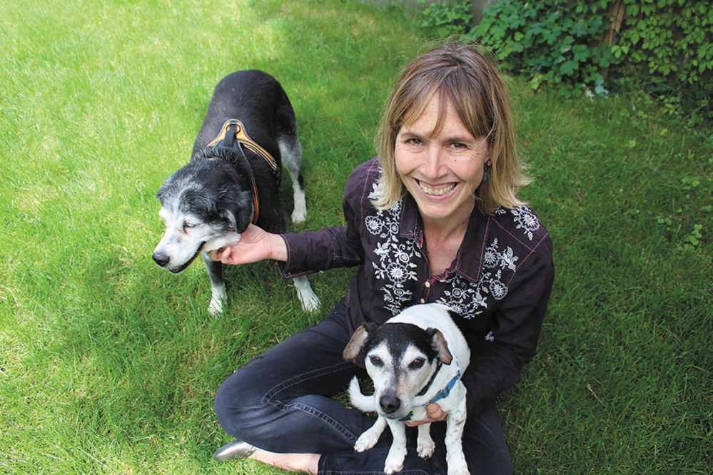 Amy Sutherland with her rescue dogs, Penny Jane, left, and Walter Joe.