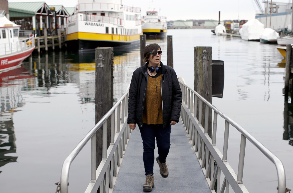 Aimsel Ponti checks out the water taxi ramp near Maine State Pier while on a walking jaunt in the Old Port.