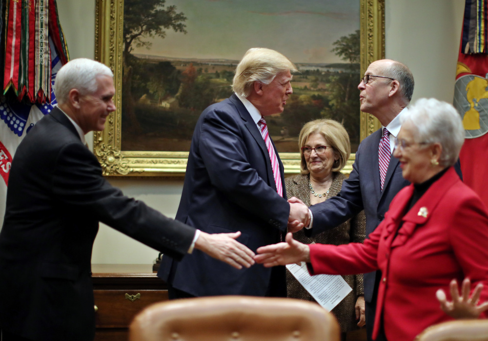 President Trump and Vice President Pence, left, meet Friday with key House committee members at the White House.