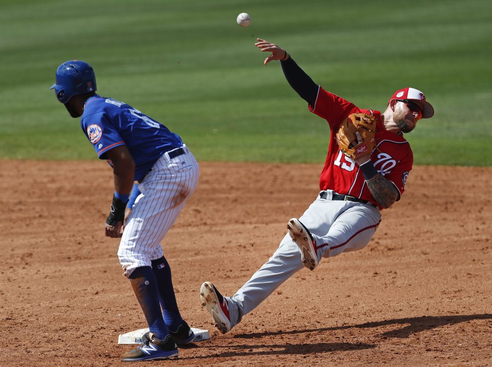 Nationals second baseman Brandon Synder falls backward after forcing out the Mets' Amed Rosario on a grounder by Wuilmer Becerra in the fifth inning of Washington's 6-0 exhibition win Saturday at Port St. Lucie, Fla.