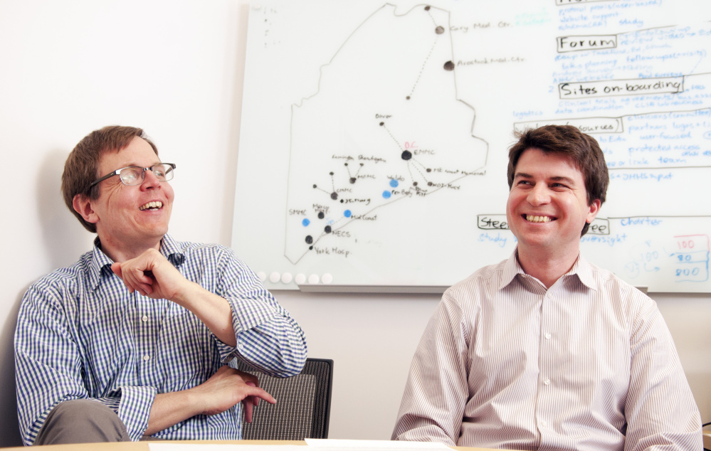 Dr. Jens Rueter, left, and Andrey Antov discuss a new genetic technology effort at Harold Alfond Center for Cancer Care, which Rueter says may lead to