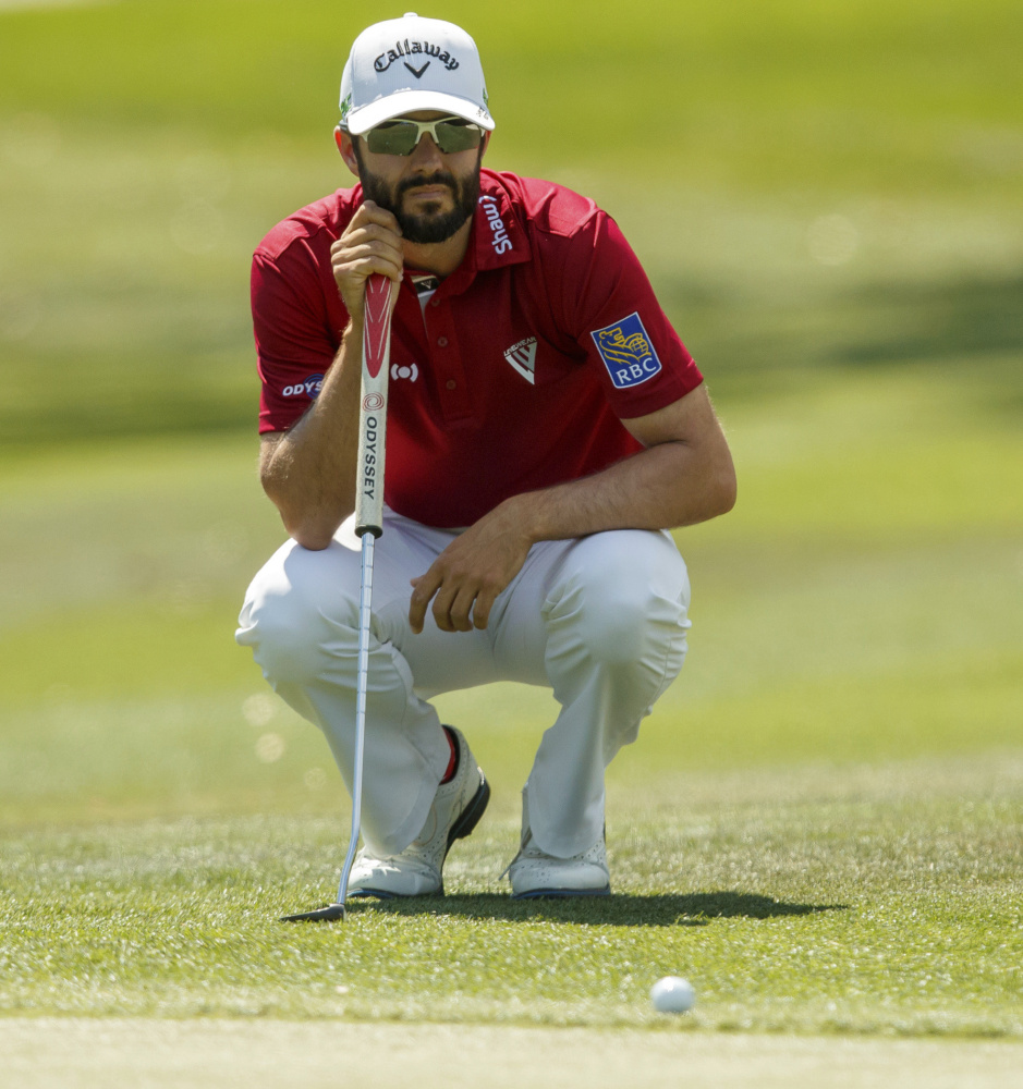Adam Hadwin lines up a putt on the first hole Saturday during the third round of the Valspar Championship in Palm Harbor, Fla. Hadwin, winless in 77 career PGA Tour events, will take a four-stroke lead into the final round.