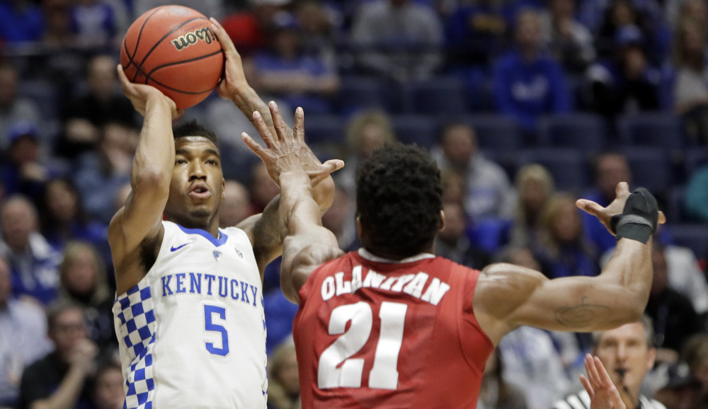 Malik Monk, who finished with 20 points for Kentucky, shoots over Bola Olaniyan of Alabama during the first half of Kentucky's 79-74 victory in the Southeastern Conference semifinals Saturday. The Wildcats will take on Arkansas in the championship game Sunday.