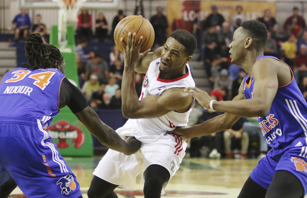 Maine's Demetrius Jackson drives while being defended by Westchester's Maurice Ndour, left, and Kevin Capers during the Red Claws' 93-85 win Sunday at the Portland Expo.