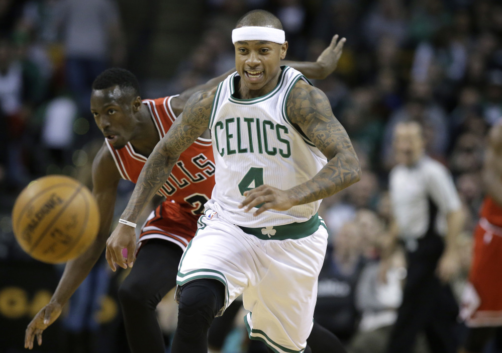 Celtics guard Isaiah Thomas and Bulls guard Jerian Grant chase the ball in the first quarter of the Celtics' 100-80 win March 12 in Chicago.