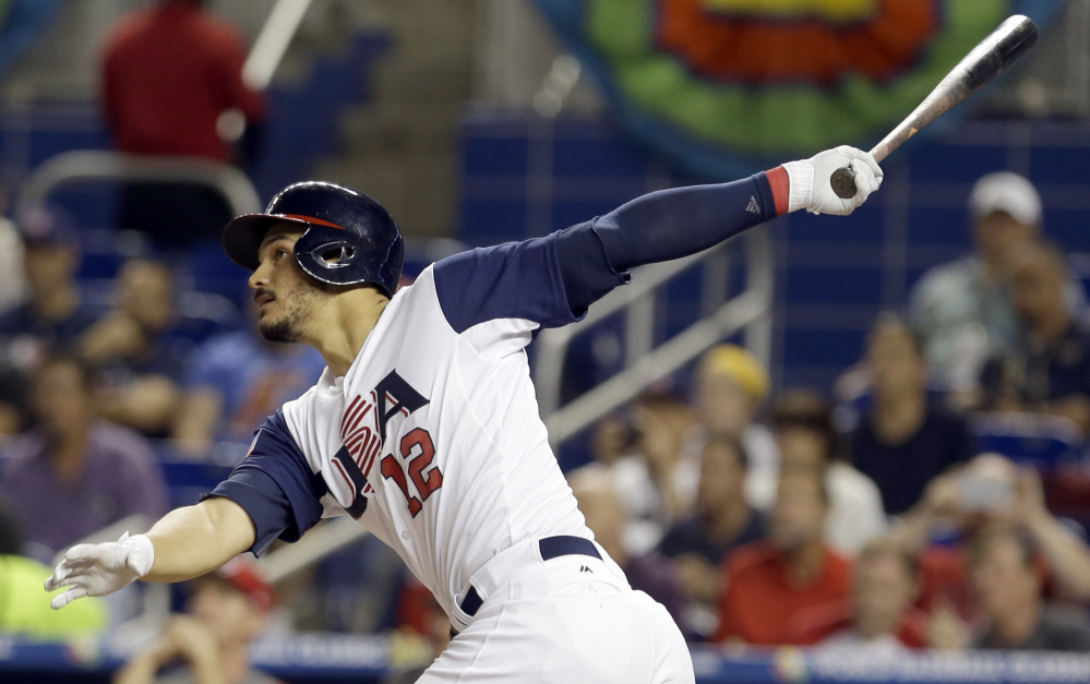 Nolan Arenado of the United States follows through on a three-run homer Sunday night in the second inning of an 8-0 victory against Canada in the World Baseball Classic in Miami.