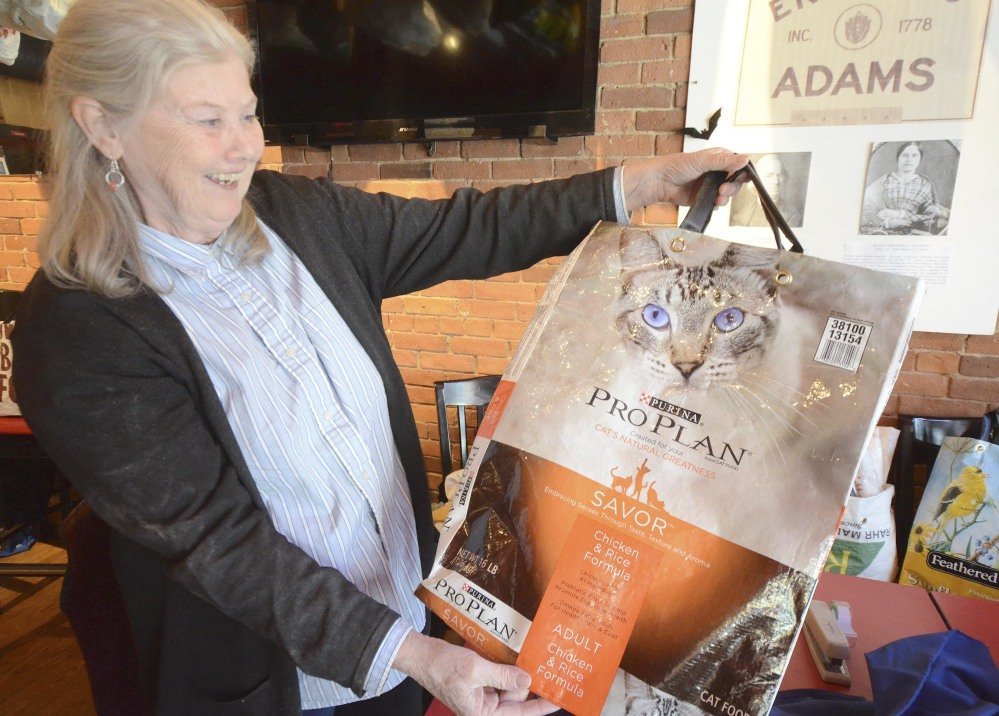 Pat Fietta holds up a reusable shopping bag made from a cat food bag. The local BagShare Project uses recycled materials, mainly feed bags and used irrigation tubing.