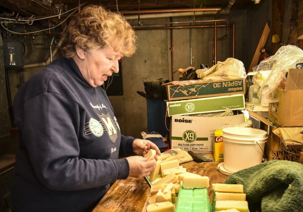 For Elaine Briggs of Wayne, aging in place means continuing to do the hobbies and crafts she enjoys doing in her own home. She is shown Sunday with her with spearmint- and lavender-infused soap that she made in the basement of her home.
