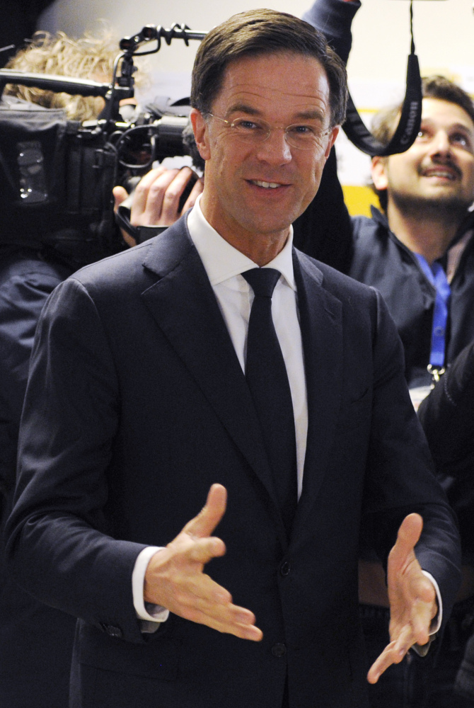 Dutch Prime Minister Mark Rutte jokes with journalists after casting his vote in the Netherlands general election on Wednesday.