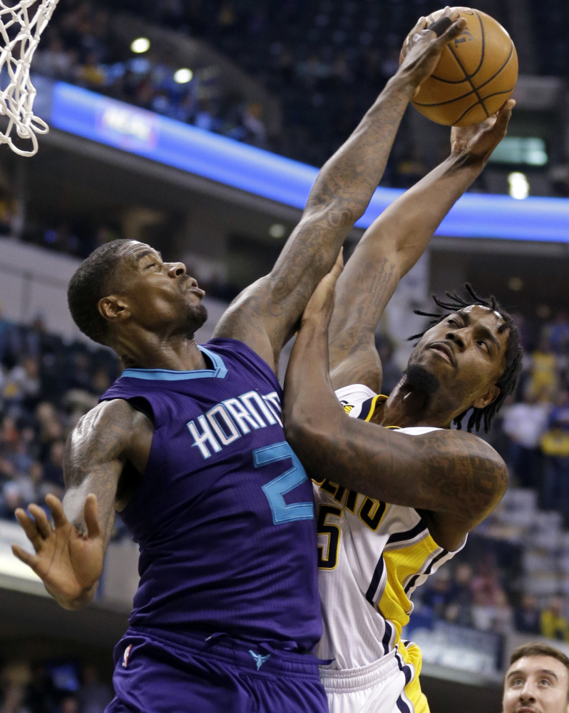 Charlotte Hornets forward Marvin Williams, left, blocks the shot of Indiana Pacers forward Rakeem Christmas during the second half of a 98-77 win by the Pacers on Wednesday at Indianapolis.