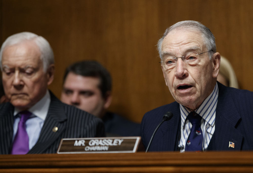 Senate Judiciary Committee Chairman Sen. Chuck Grassley, R-Iowa, right, says he has been having trouble getting information.
