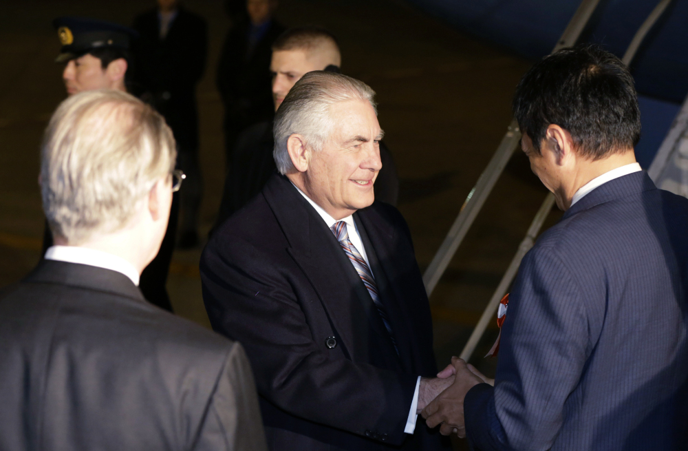 U.S. Secretary of State Rex Tillerson, center, is greeted Wednesday at Haneda International Airport in Tokyo, the first stop on a trip that will include visits to China and South Korea.