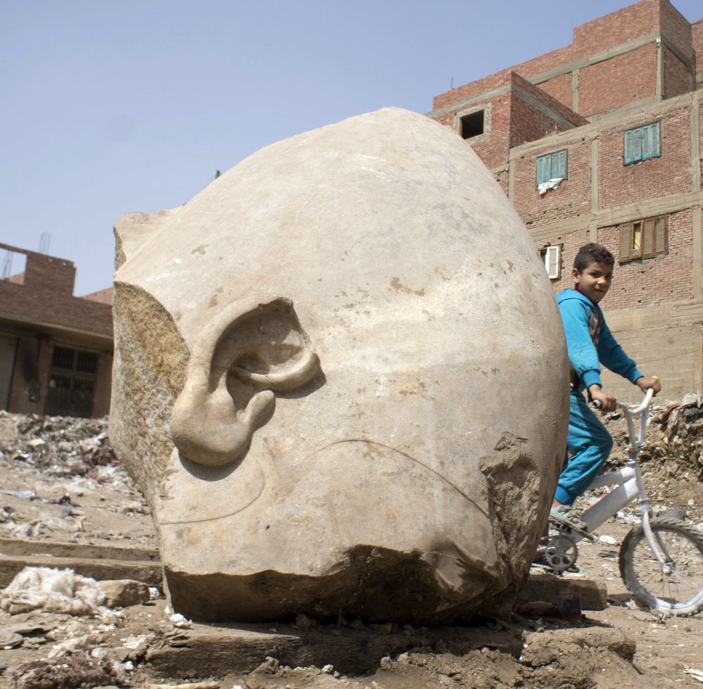A colossal statue recently found buried in a Cairo slum appears to be a likeness of pharaoh Psamtek I. The statue, discovered by a German-Egyptian team, was originally thought to be a likeness of Ramses II.