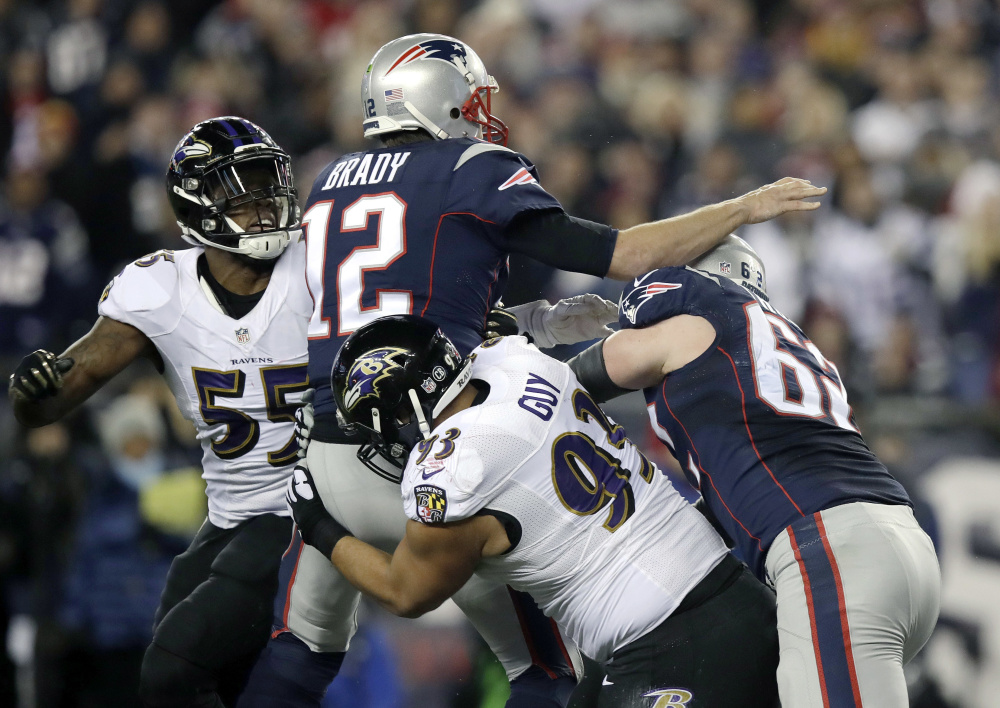 Defensive end Lawrence Guy, bottom, had many chances to sack Tom Brady over the past three seasons as a member of the Ravens. This season, though, Guy looks forward to being a part of the New England franchise.