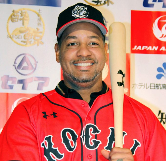 The uniform is red, but Manny Ramirez isn't with the Boston Red Sox. Now it's the Kochi Fighting Dogs.