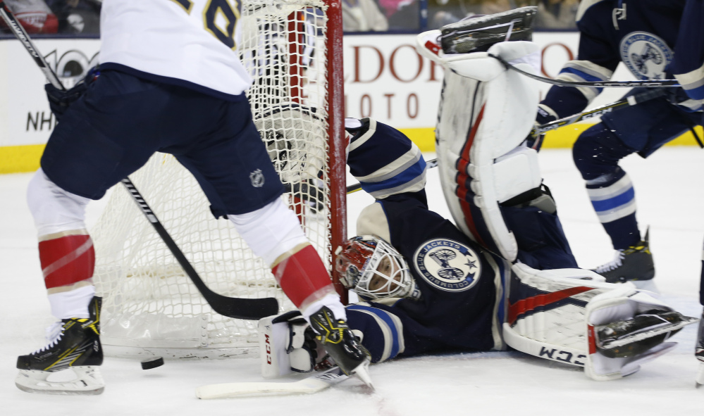 Sergei Bobrovsky, goalie for the Columbus Blue Jackets, sprawls to make a save against the Florida Panthers during the first period of a 2-1 win by the Blue Jackets on Thursday night at Columbus, Ohio.