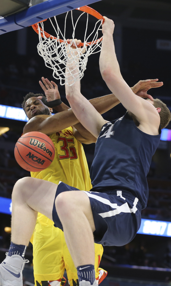 Sean O'Mara, who finished with 18 points for Xavier, dunks against Damonte Dodd of Maryland during the first half of Xavier's 76-65 victory Thursday. O'Mara shot 5 of 6 from the field.