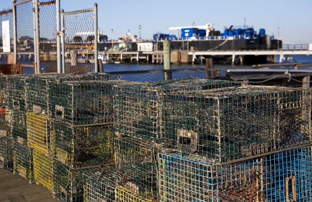 SOUTH PORTLAND, ME - JANUARY 16: Lobster traps sot on the Portland Street Pier, a city-owned pier that is one of the waterfront piers the city of South Portland is taking steps to revitalize in the hope of encouraging aquaculture enterprises. (Photo by Brianna Soukup/Staff Photographer)