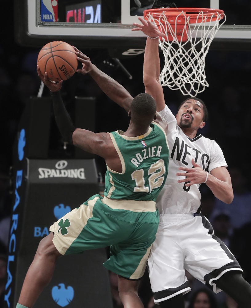 Boston's Terry Rozier goes up for a shot against Brooklyn's Spencer Dinwiddie in the second quarter Friday night in New York.