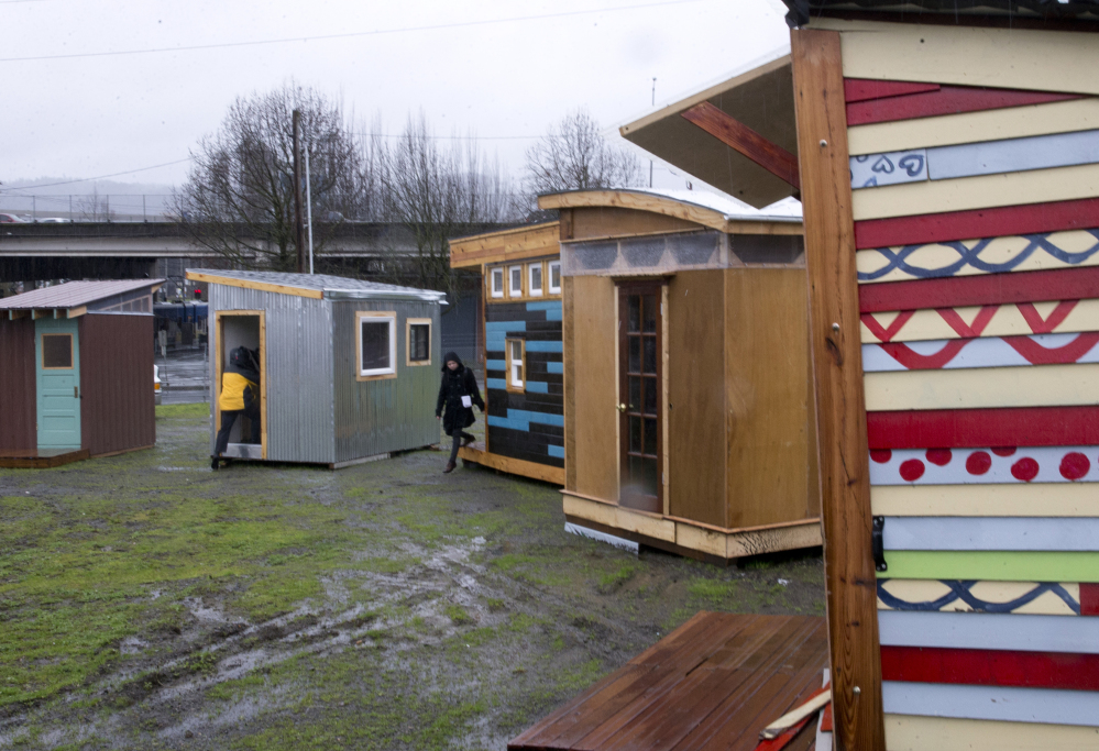Examples of the Kenton Neighborhood Tiny Home Pilot houses in Portland, Ore. Tiny houses will be located in willing participants' backyards.