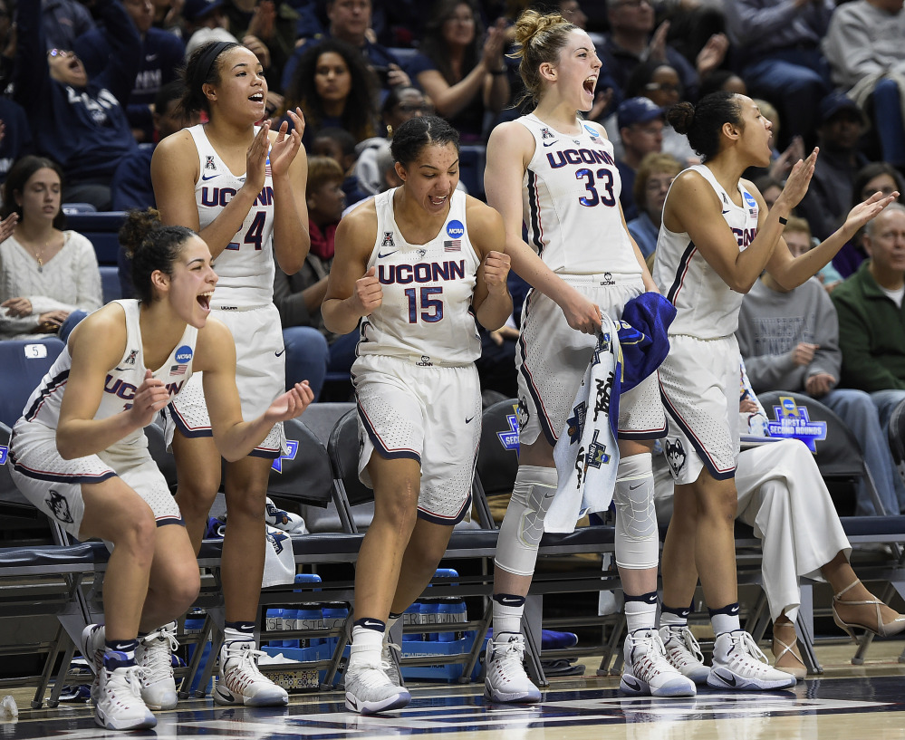 Connecticut's Kia Nurse, Napheesa Collier, Gabby Williams, Katie Lou Samuelson and Saniya Chong celebrate during the second half of their rout of Albany on Saturday.