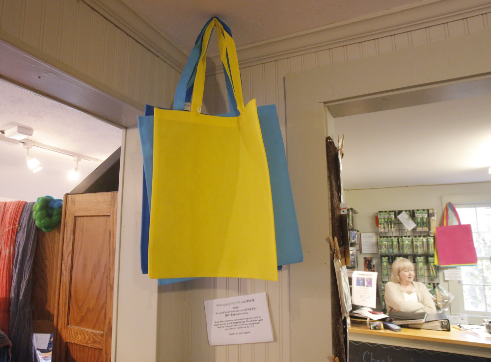 Reusable bags are offered for sale at The Yarn Sellar in York, which in 2015 became the first Maine community to ban the single-use plastic bags used by many businesses.