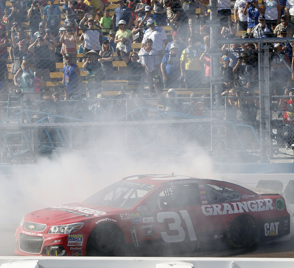 Ryan Newman does a burnout in front of the grandstands to celebrate his victory in the NASCAR Cup Series auto race at Phoenix International Raceway, Sunday, March 19, 2017, in Avondale, Ariz. (AP Photo/Ralph Freso)