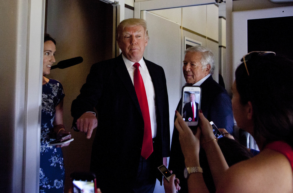 President Trump, shown speaking to the media aboard Air Force One in Palm Beach, Fla., on Sunday, has not backed down from his wiretapping allegation. Standing beside Trump is New England Patriots owner Robert Kraft. The two are known to be close friends. Kraft was also seen following Trump into the White House shortly before 7 p.m., The Boston Globe reported.