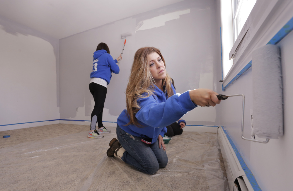 Erica Albair, right, and Rose Bowdoin paint a room Monday at an Old Orchard Beach apartment offered temporarily to the Doucettes, who lost their belongings and pets in a Saturday house fire at 19 Harmon Ave. The pair set up a fundraising web page for the family.