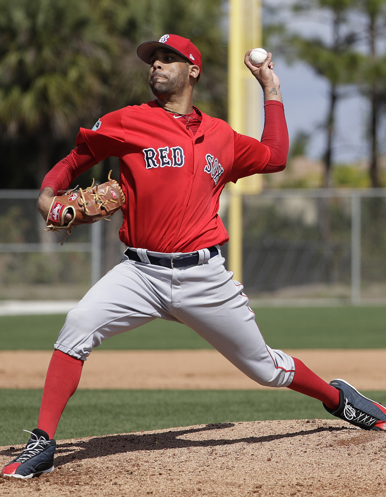 Boston Red Sox pitcher David Price throws a live batting session at a spring training baseball workout in Fort Myers, Fla., in February. The Sox ace has yet to pitch in a spring training game.